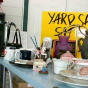 A table full of items for sale at a garage sale.