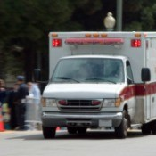 An ambulance in a parade.
