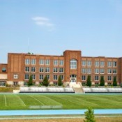 Photo of a large high school and its football field.
