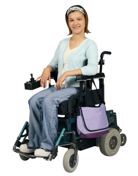 A young woman in an electric wheelchair.