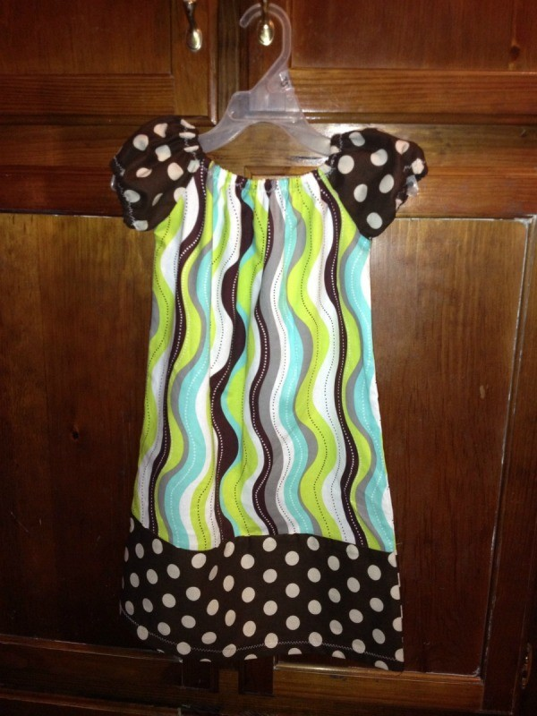 Cap sleeve dress with polka dot sleeves and bottom.