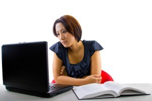 A girl taking an online course using her laptop.