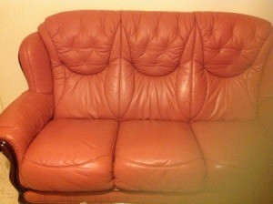 Rose colored leather couch.