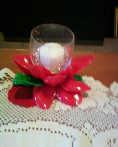 Red spoon flower votive holder.