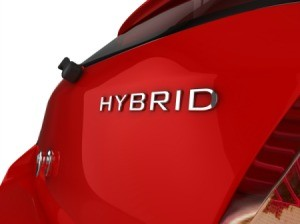 The back of a red hybrid car.