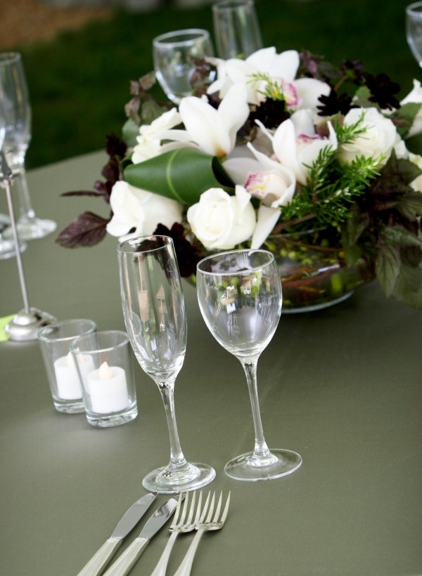 Wedding rehearsal table with a nice floral centerpiece.
