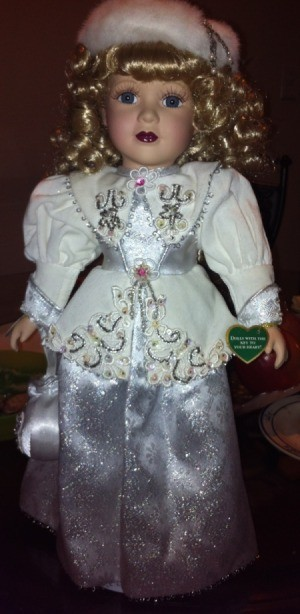 Full view of doll and detail on dress.