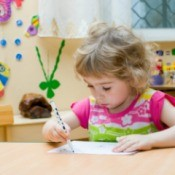 Preschool aged girl learning at home.