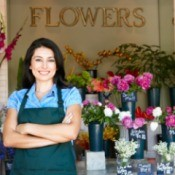 Female florist standing in her shop.