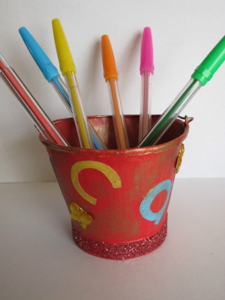 Bucket with colored pens.