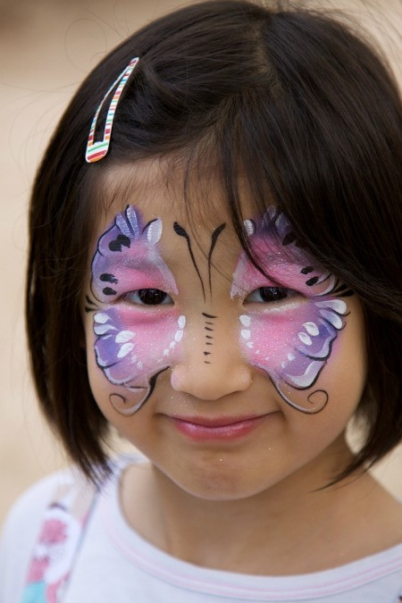 Young girl with face paint on.