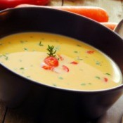 A bowl of carrot soup.