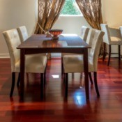 A dining room with hardwood floors.