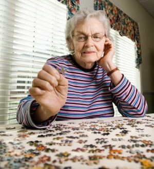 A woman working on a puzzle.