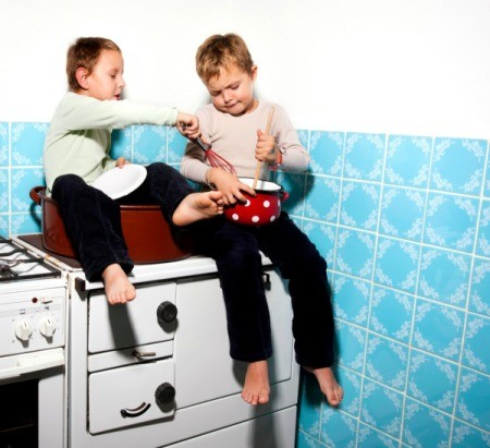 Boys Sitting on Counter in Kitchen