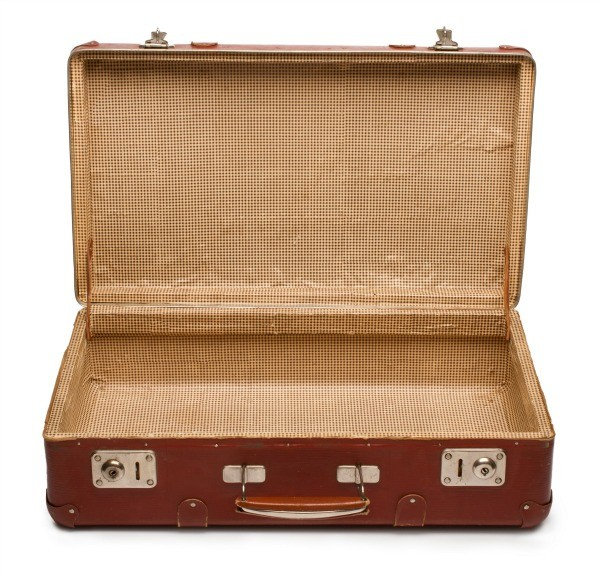 An old suitcase sitting open.