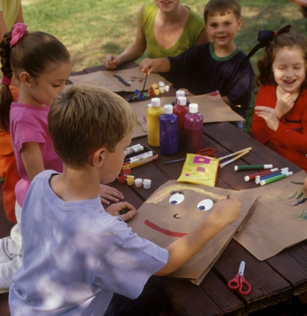 Kids working on crafts at a summer day camp.