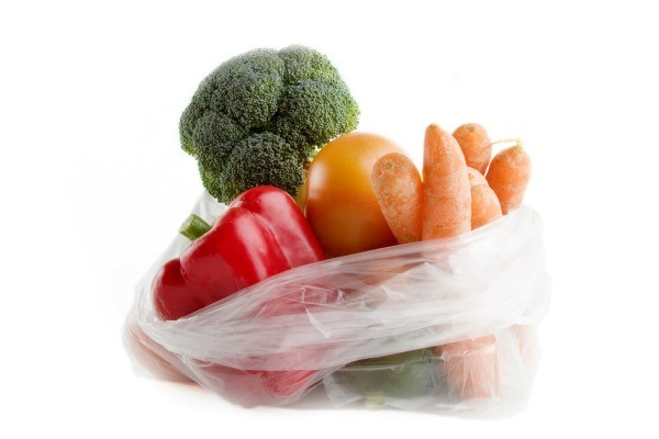 Plastic produce bag full of vegetables.