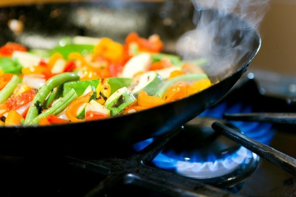 A healthy meal of wok fried vegetables being prepared.