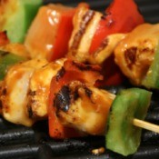 Grilling kabobs for a summer party.