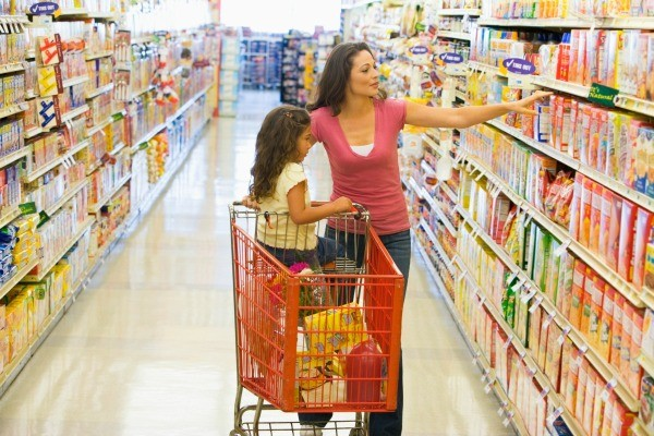 A mom shopping at the grocery store.