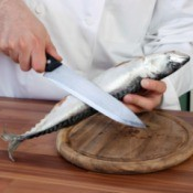 chef cleaning a fish