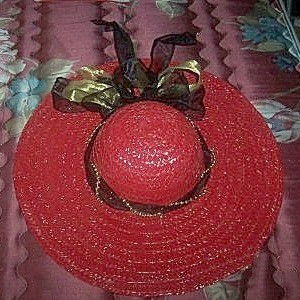 Red straw hat.
