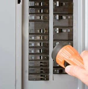 Person looking at circuit breakers.
