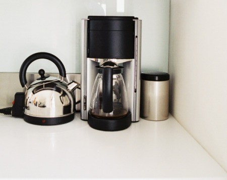 A coffee maker in the kitchen.