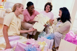 Women looking at a baby shower gift