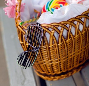 Pair of fun glasses sticking out of a gift basket.