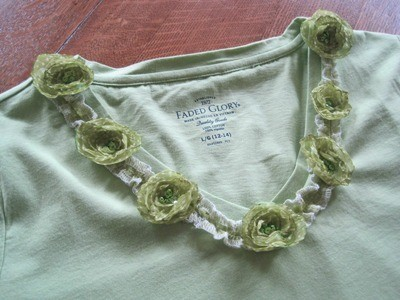Green tee with flowers around neckline.