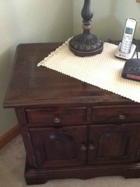 Dark finish wood nightstand.