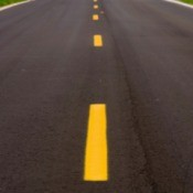 Road with freshly painted yellow lines.