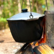 A pot cooking over a fire.