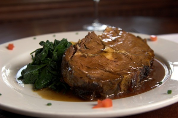 Prime rib with spinach.