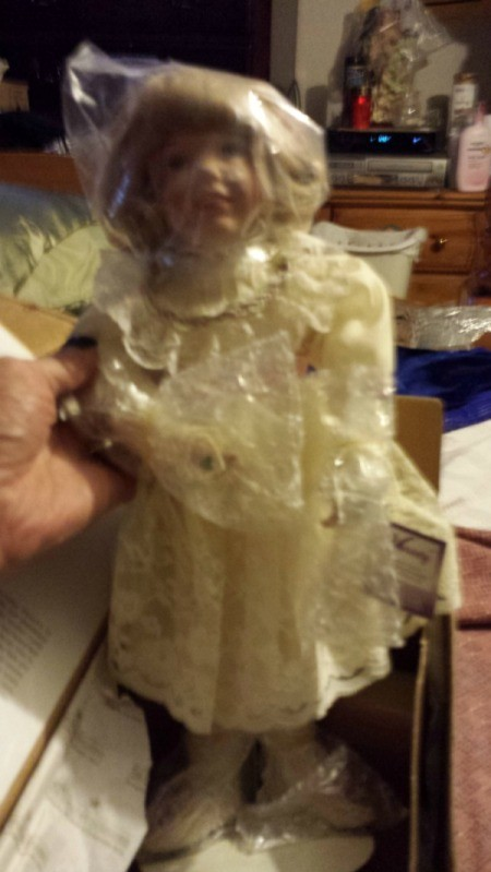 Ruth Mattingly doll with plastic over face and upper body.