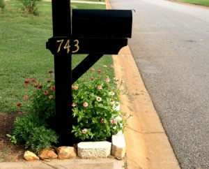 Nice landscaping around a black mailbox.