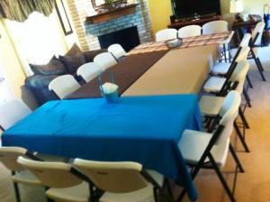 Tables set up for a group meal.