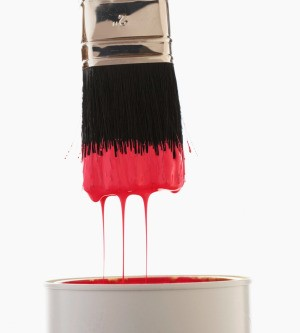 Paint can with red paint.