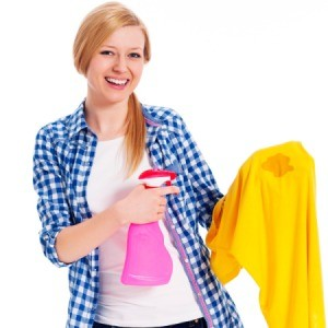 Woman removing a Grease stain.