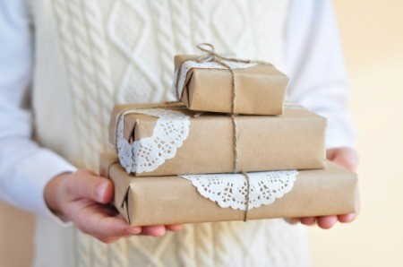 Presents wrapped in paper with doilies as accents.