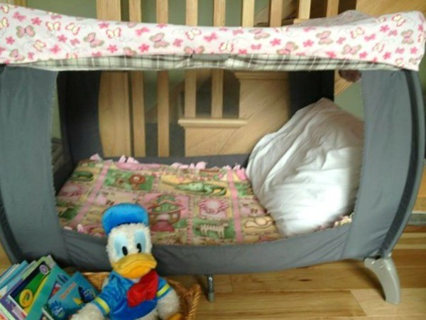 playpen made into reading nook