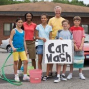 Group of people having a fundraising carwash.