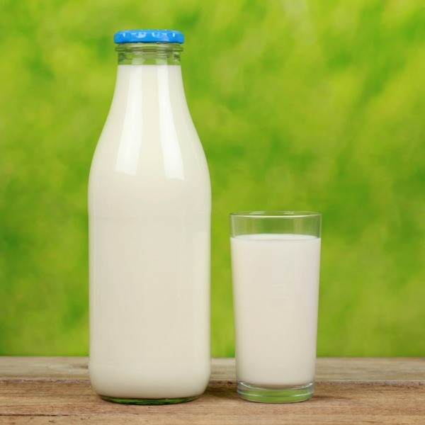 Buttermilk in glass bottle and cup.