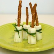 broom sticks standing on plate