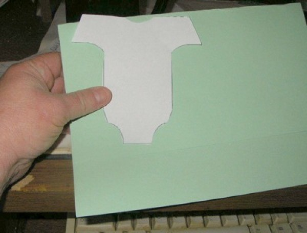 Holding template up to paper.