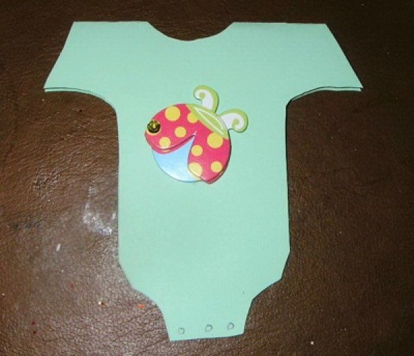 Invitation with ladybug on front of onesie.