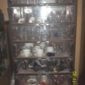 Glass fronted cabinet with shelves.