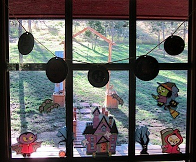 Lid decorations hanging in window.